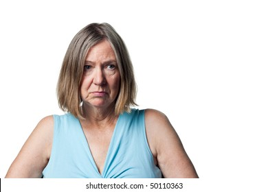Woman looks sad and dejected, upset at something