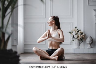 Woman in lotus position. Yoga at home.