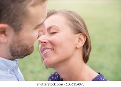 Woman in love ready to kiss her boyfriend outdoor