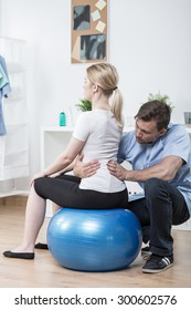 Woman with lumbar hyperlordosis exercising with physiotherapist