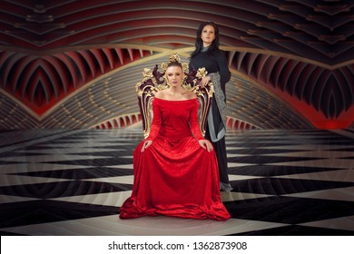 A woman in a luxurious gown dress sitting on a queen's throne, another one standing up behind her in long black dress