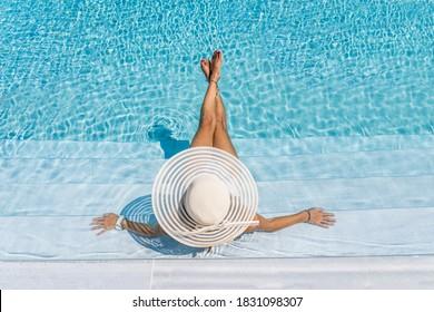 woman in luxury five stars  spa resort in the swimming pool.  - Shutterstock ID 1831098307