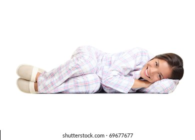 Woman lying down cute in pajamas and slippers. Isolated on white background. Mixed race Asian Chinese / white Caucasian girl.