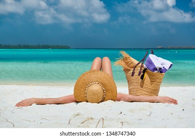 Woman lying down on beach. Summer vacation at Maldives.