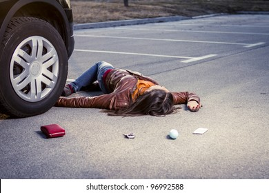 Woman lying injured on the pavement