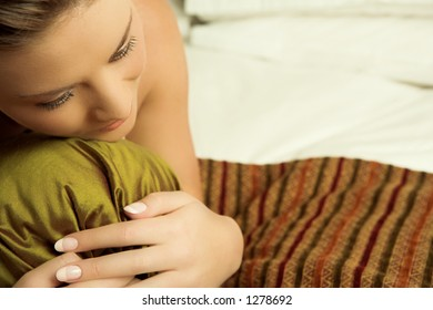 Woman in lying on a bed.