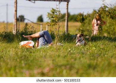 Woman lying on the grass with a dog