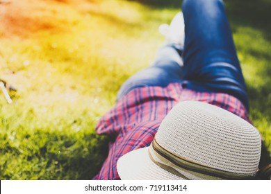 a woman lying on the grass floor for relax with happiness