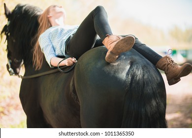 woman lying on the horse and hugging him, horse standing in nature and jockey love rides and sending love