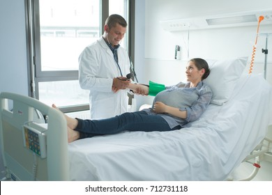 woman lying on the hospital bed in the ward