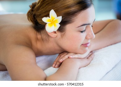Woman lying on massage table at spa