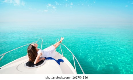woman lying on a private yacht in the sea