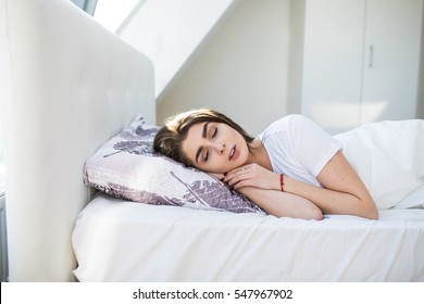 Woman lying and sleeping in bed