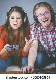 Woman is mad at her boyfriend because he play video games being addicted to gaming. Female complaining.