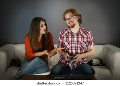 Woman is mad at her boyfriend because he play video games being addicted to gaming.