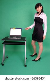 Woman with magic wand and laptop with blank screen.