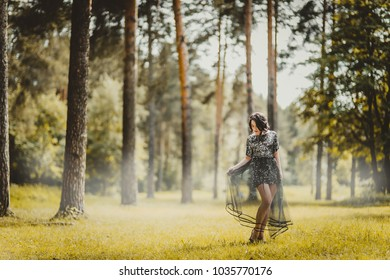woman in magical dress in forest
