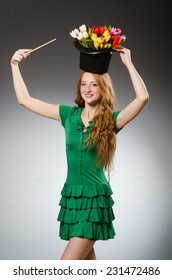 Woman magician wearing green dress
