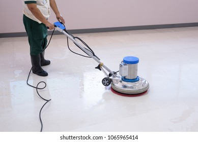 Woman maid cleaning floor with machine cleaner.Big cleaning day.