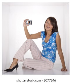 woman makeing picture by cellural phone/palmtop in the white cramped cube