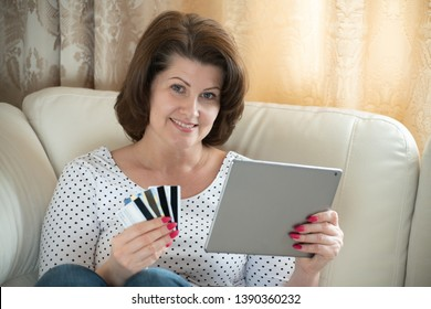 A woman makes a purchase in the Internet by credit card