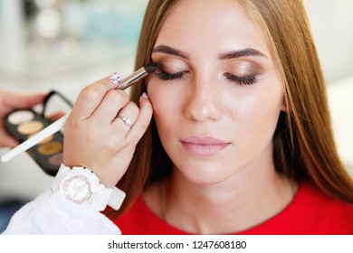 Woman and Makeup Artist