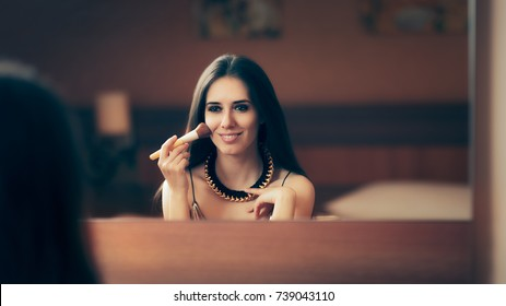 Woman With Makeup Brush Getting Ready for Party - Beautiful girl in front of a mirror preparing for a night out