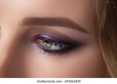 Woman Makeup. High Fashion Model Girl Portrait, Professional make-up in the eyes. Sexual look. Bright Smokey make-up.Eyebrows Makeup. High Resolution