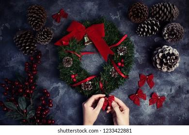 Woman making Christmas wreath Flat lay. Top view. Xmas Workshop.