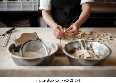 Woman making farfalle pasta at a restaurant