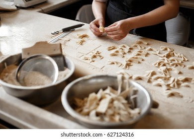 Woman making farfalle pasta at a restaurant