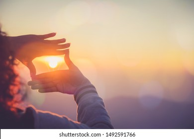 The woman making frame round the sun with her hands in sunrise,Future planning idea concept. - Shutterstock ID 1492591766
