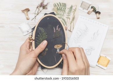 Woman making handmade embroidery. Process of making embroidery. Hobby. Sewing tools.