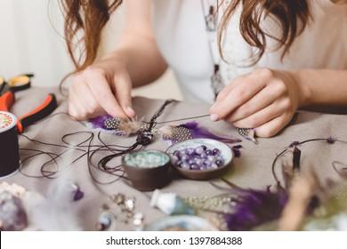Woman making handmade gemstone jewellery, home workshop. Artisan woman creates jewellery. Art, hobby, handcraft concept