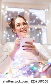 Woman making her christmas wishlist and new year resolutions