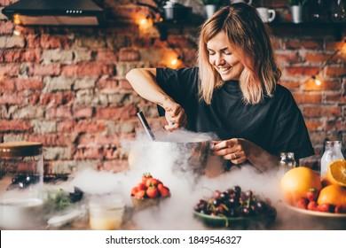 Woman making ice cream with liquid nitrogen.