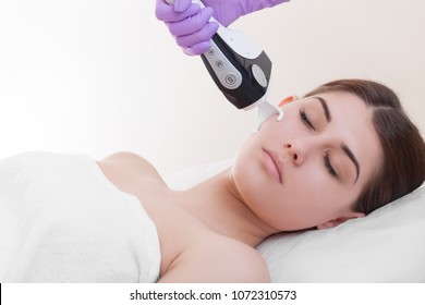 woman making laser skin resurfacing in aesthetic medicine.