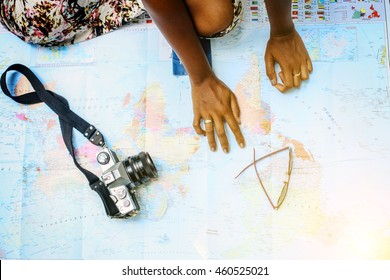 Woman making list for traveling. Shoot from above.