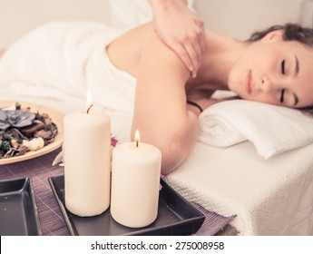 woman making massage in a beauty saloon. concept about spa, relaxation, body care and people