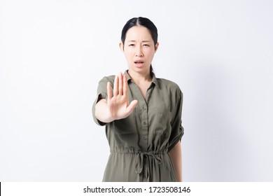 A woman making an NG sign