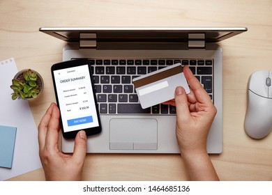 Woman making online credit card payment. Top view
