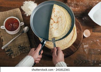 Woman making pancakes.