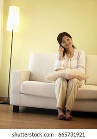 woman making phone call at home