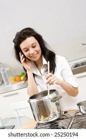 woman making a phone call while cooking