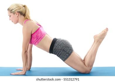 Woman making pilates mat exercises.
