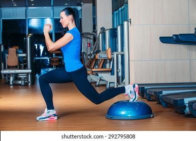 Woman making squats on balance trainer fg fgf fgfg