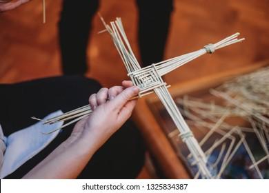 Woman making St Brigids cross