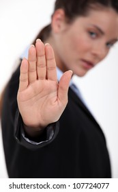 woman making stop gesture with hand