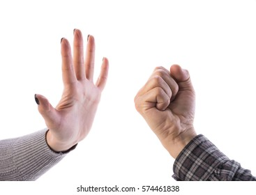 Woman making stop gesture, man showing fist on a white background. Stop the violence