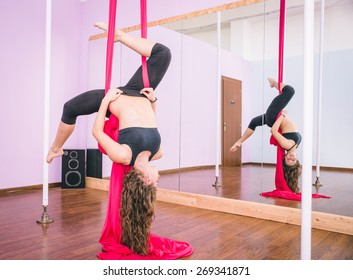 woman making training with elastic in the gym. Elastics are part of the pole dancing discipline. concept about sport, fitness, dancing and people